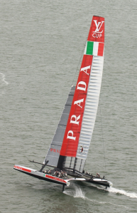 "The confusion doesn't stop just at the referencing of the America's Cup. This is the Italian boat, racing in the Louis Vuitton Cup. It's called Luna Rossa and is sponsored by Prada. It's mostly referred to as ""Luna Rossa"" or ""the Italians"", but I've heard ""Prada"" bandied around too. (Photo courtesy of ACEA and Gilles Martin-Raget)"