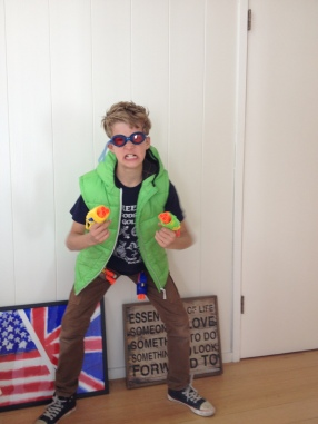 Here he is, ready for action at a nerf gun party.