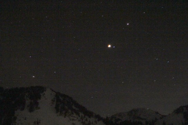 A blood moon over the snow-covered mountains. Now imagine howling too.