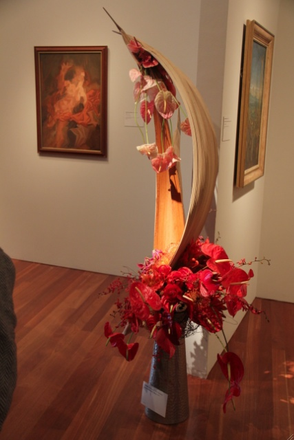 The painting of Venus is jagged, but the floral display is sinuous