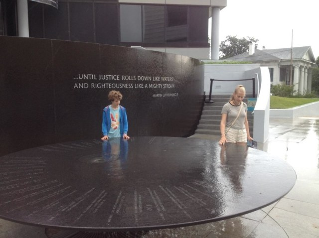 "The Civil Rights Memorial in Montgomery, commemorating the efforts and lives of the major protagonists between 1954 and 1968. Water runs continuously over the table, representing the water in MLK's speech: ""...Until justice runs down like waters and righteousness like a might stream."""